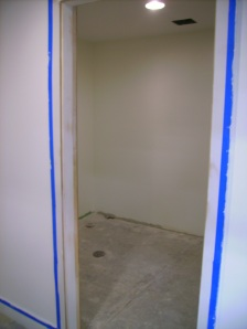 Women's bathroom, painted and ready for tile.