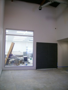 The window and doors into the brewhouse are installed.