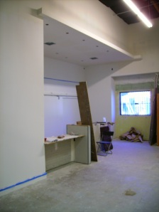 The tasting bar with primed walls.